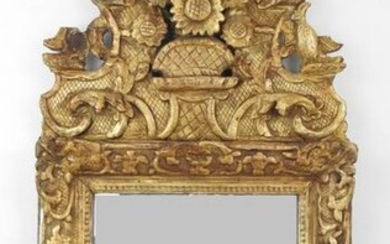 MIRROR with gilded carved wood pediment decorated with...