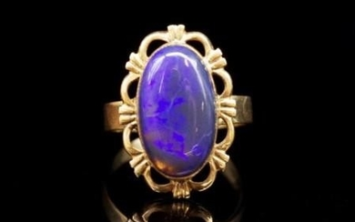 Opal and 9ct yellow gold cocktail ring marked 9ct.Circa 1960...