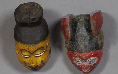 Pair of African Carved Wood Masks, with polychromed