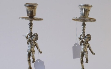 Pair of silver candlesticks, 800, decorated with putto, with loose fat catchers (bobeches), h. 23 cm, brand: Sorel, upper part slightly bent, appr. 770 grams (2x)