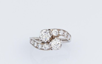 """Ring """" Toi et Moi"""" in 750°/°°° white gold and 950°/°°° platinum set with two old cut diamonds in a claw setting in an entourage of old and modern cut diamonds."""