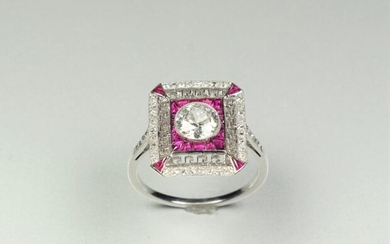 Ring in 18K (750/oo) white gold, the rectangular cut-faceted plateau centered on an antique cut diamond calibrating about 0.85 ct, the surround and corners adorned with calibrated rubies (some probably synthetic) in Greek decoration and lines of...