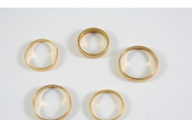 THREE 22CT GOLD WEDDING BANDS 8.6 grams, together with two u...