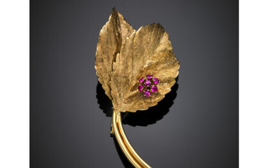 Yellow partly glazed gold leaf brooch accented with synthetic rubies,...