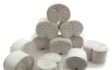 11 linen blanket rolls, folded and stitched in decorative pattern. Circa 1900. (11) – Bruun...
