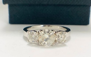 14ct White Gold Diamond trilogy ring featuring centre,...