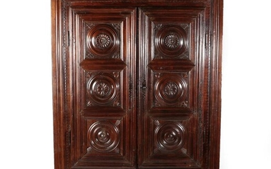 A 17th Century French Walnut Armoire, of pegged construction, the...