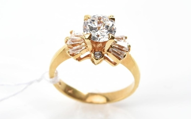A CUBIC ZIRCONIA DRESS RING IN 18CT GOLD