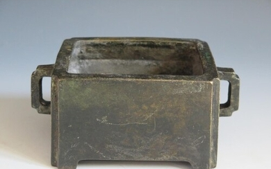 A Chinese Bronze Censer with lug handles, four character mar...