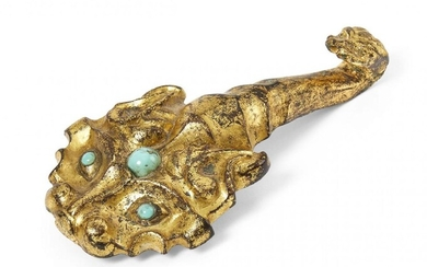 A Chinese gilt bronze belt hook, Han dynasty, finely cast...