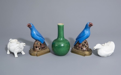 A Chinese monochrome green vase, two animal shaped...