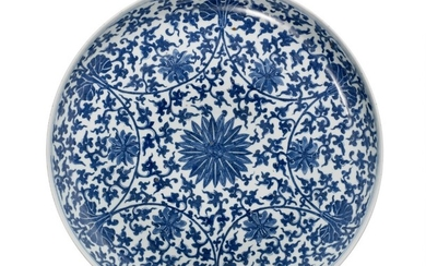 A Chinese porcelain dish decorated in underglaze blue with flowers and foliage in Kangxi manner. Late Qing, c. 1900. Diam. 47.5 cm.