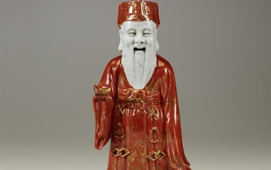 A Chinese porcelain figure of Caishen, God of Wealth...