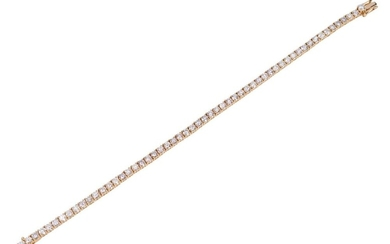 A DIAMOND LINE BRACELET IN 18CT GOLD, COMPRISING FIFTY SIX ROUND BRILLIANT CUT DIAMONDS TOTALLING 5.98CTS, LENGTH 180MM