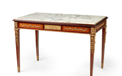 A Louis XVI style marble top gilt bronze mounted mahogany center table
