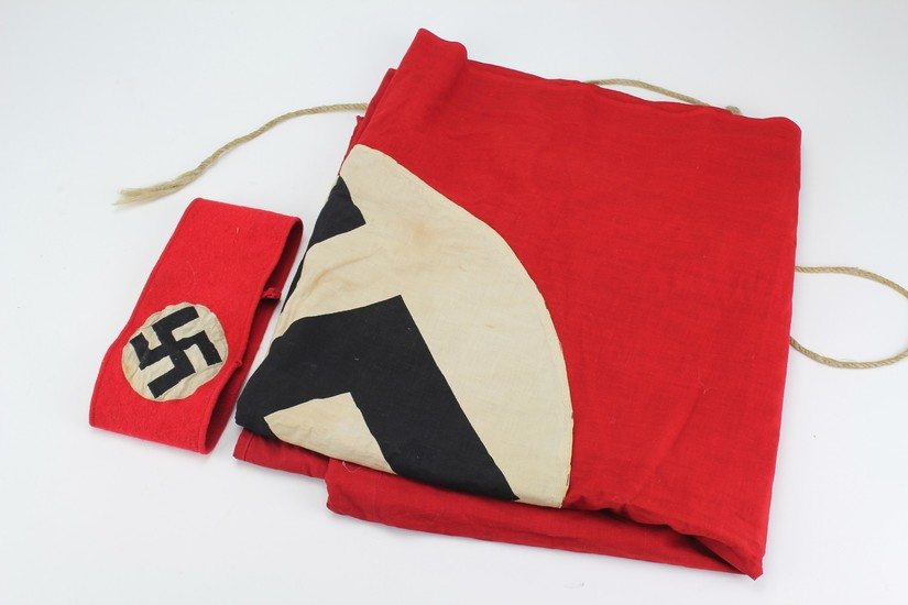 A Nazi red and white circular linen flag, black printed swas...