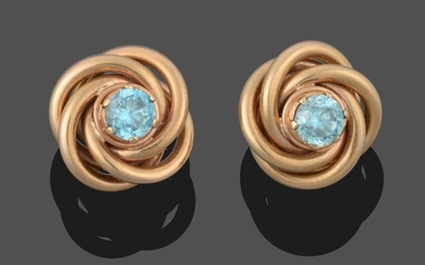 A Pair of Blue Zircon Knot Earrings, the round cut...