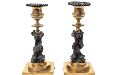 A Pair of French Gilt Bronze and Ebonized Figural Candlesticks