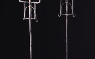 A Pair of Wrought Iron Twin-Branch Standard Lamps with electric 'candle' lights, fashioned as 18th c