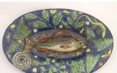 A 19thC French Palissy ware majolica dish of oval form with ...