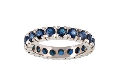 A SAPPHIRE ETERNITY RING, set with circular stones, mounted ...