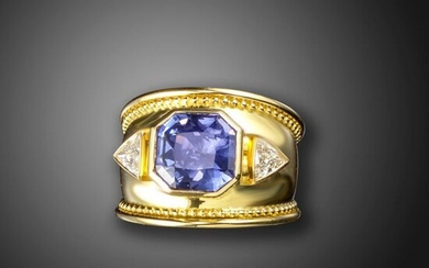 A colour change sapphire and diamond ring, the octagonal sapphire weighs 6.48cts and is flanked with triangular shaped diamonds in wide yellow gold mount with pellet borders, size P Accompanied by report number 984222 dated 5 October 2007 from The...