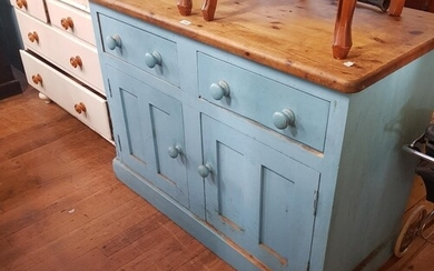 A painted pine dresser, having two drawers above two cupboar...