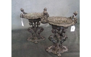 A pair of 20th century bronzed tazzas on stands in the form ...