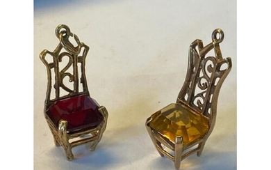 A pair of 9ct gold chair charms, one with a garnet Cushion a...