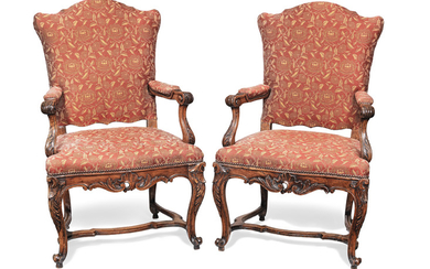 A pair of French 19th century walnut fauteuils