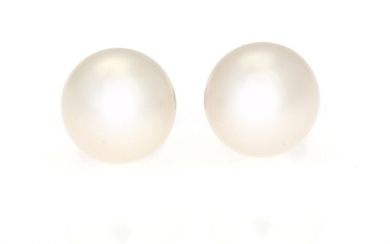 SOLD. A pair of pearl ear studs each set with a cultured pearl, mounted in...
