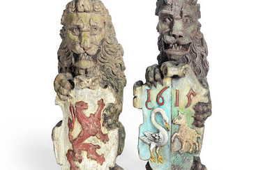 A pair of polychrome painted carved oak heraldic newel finials