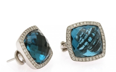 A pair of topaz and diamond ear pendants each set with a fancy-cut London Blue topaz encircled by numerous diamonds, mounted in 18k white gold. (2)