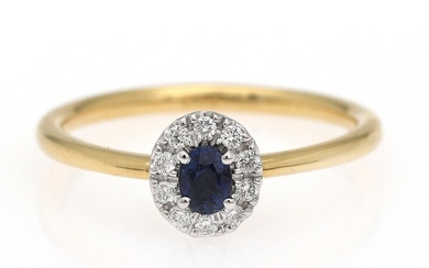 NOT SOLD. A sapphire and diamond ring set with a sapphire encircled by diamonds, mounted...