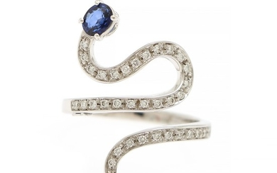 A sapphire and diamond ring set with an oval-cut sapphire and numerous brilliant-cut diamonds, mounted in 18k white gold. Size app. 56.