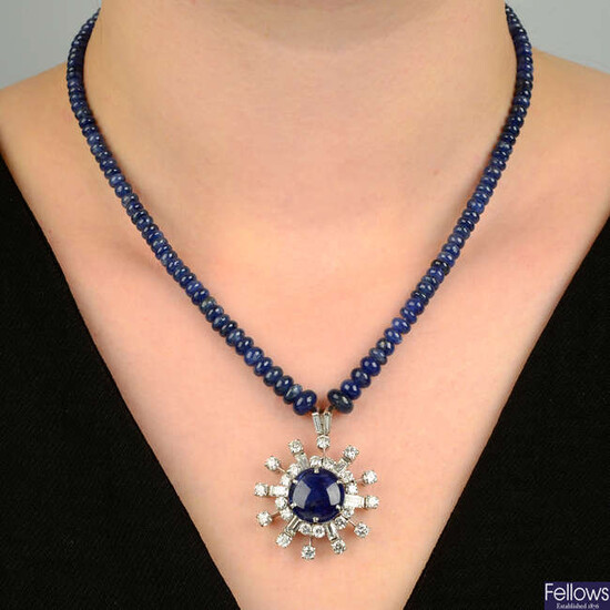 A sapphire cabochon and vari-cut diamond cluster pendant, on sapphire bead necklace.