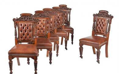 A set of six carved walnut dining chairs