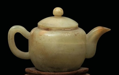 A yellow jade teapot, China, early 1900s