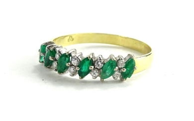 An 18ct emerald and diamond half hoop eternity ring, set wit...