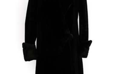An Early 20th Century Black Evening Coat, with collar, fold...