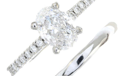 An oval-shape fracture-filled diamond single-stone ring and a polished band ring.