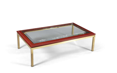 COFFEE TABLE A glass topped coffee table on...