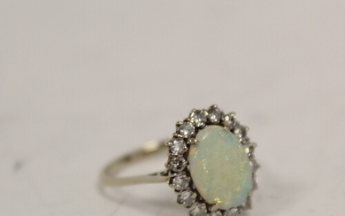 Diamond and opal oval cluster ring with sixteen brilliants i...