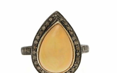 Jewels CPH: An opale and diamond ring set with a pear-shaped opale encircled by numerous sinlge-cut diamonds, mounted in sterling silver. Size 52.