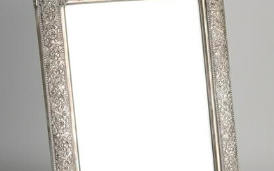 Large rectangular mirror with a richly decorated silver
