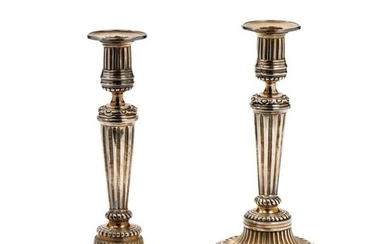 Pair of candlesticks in silver plated bronze, the...