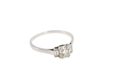 Platinum ring (950°/°°) set with one emerald cut diamond shouldered with two baguette cut diamonds Gross