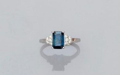 Ring in white gold, 750 MM, set with an emerald cut sapphire weighing 1.40 carat, beautiful colour, stepped brilliants, 13 x 9 mm, size: 52, weight: 2.65gr. gross.