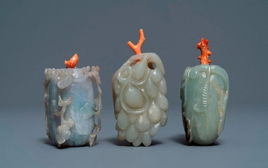 Three Chinese jade snuff bottles with coral stoppers,...