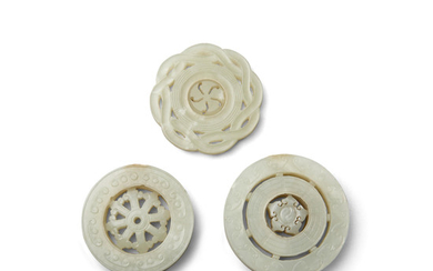 Three jade circular plaques undercut with movable roundels